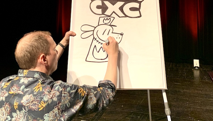 Cartoonist Dav Pilkey draws a character from his Captain Underpants book series on the stage of Mershon Auditorium during the 2020 Cartoon Crossroads Columbus