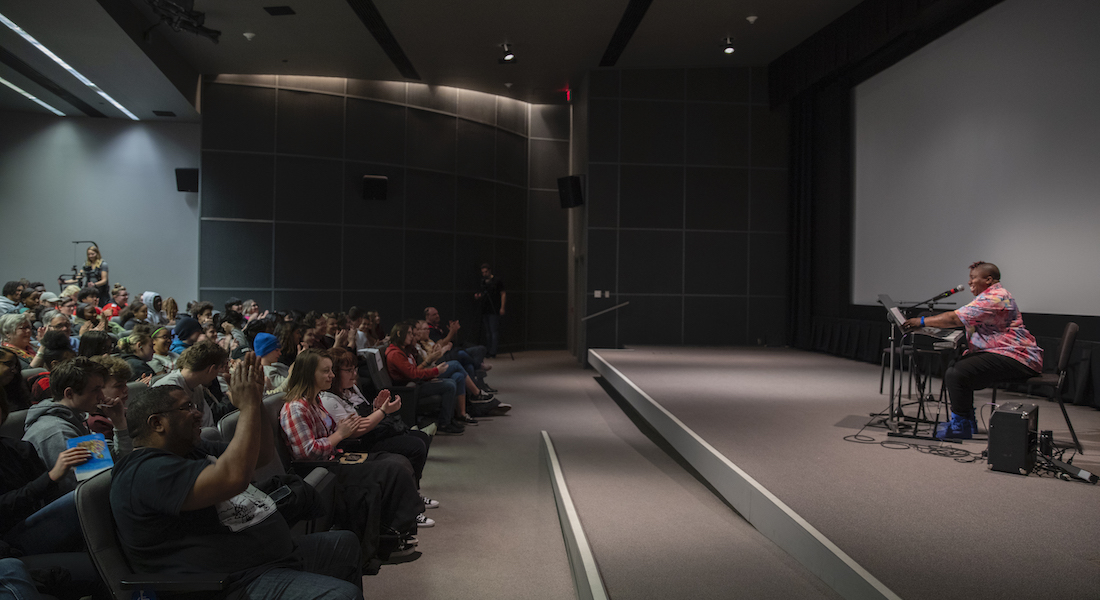 Columbus musician Sharon Udoh performs for high school students in the Film/Video Theater of the Wexner Center for the Arts in January 2020