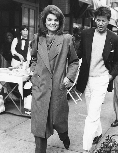 A candid Bill Cunningham photo of Jacqueline Kennedy Onassis and Calvin Klein in New York City, 1987.