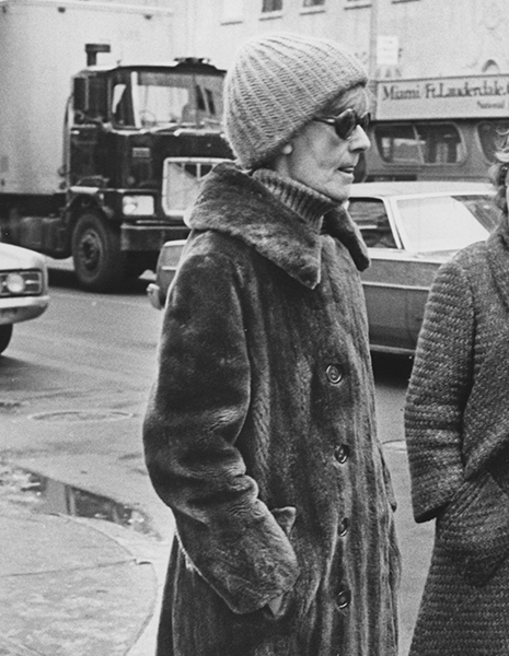 A candid photo of Greta Garbo in a nutria coat walking along a street in New York City, 1978.