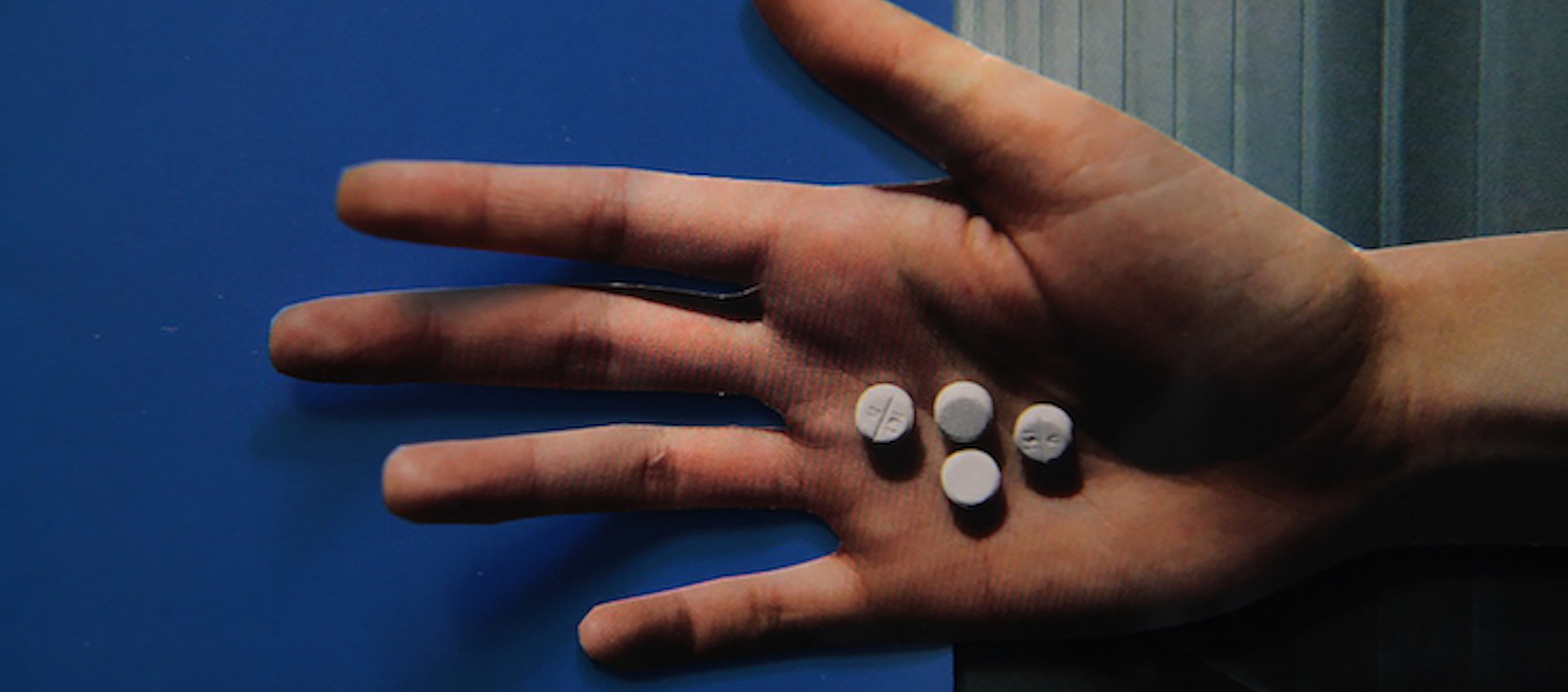 Hand holding pills from Lewis Klahr's Circumstantial Pleasures