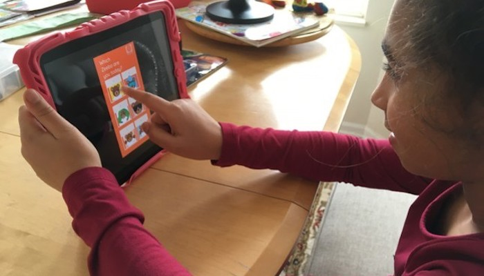 A young girl participates in a remote class from the Cleveland Play House via tablet