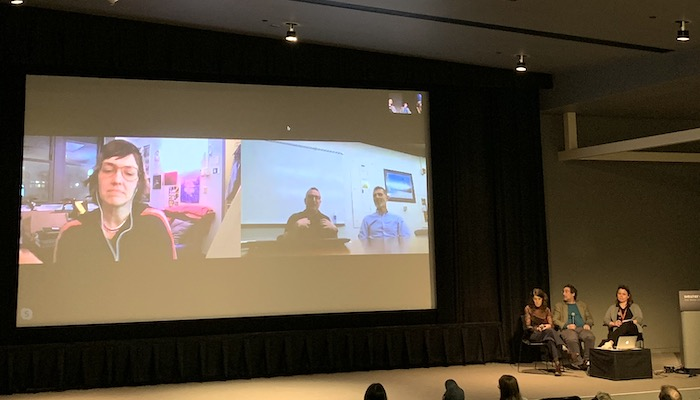 Filmmakers Lynne Sachs and Mark Street and Film/Video Studio Curator Jennifer Lange (L to R, onstage) chat via Skype with filmmakers Deborah Stratman, Dan Veltri, and Frank Lester (on screen) in the Wexner Center Film/Video Theater, November 4, 2019