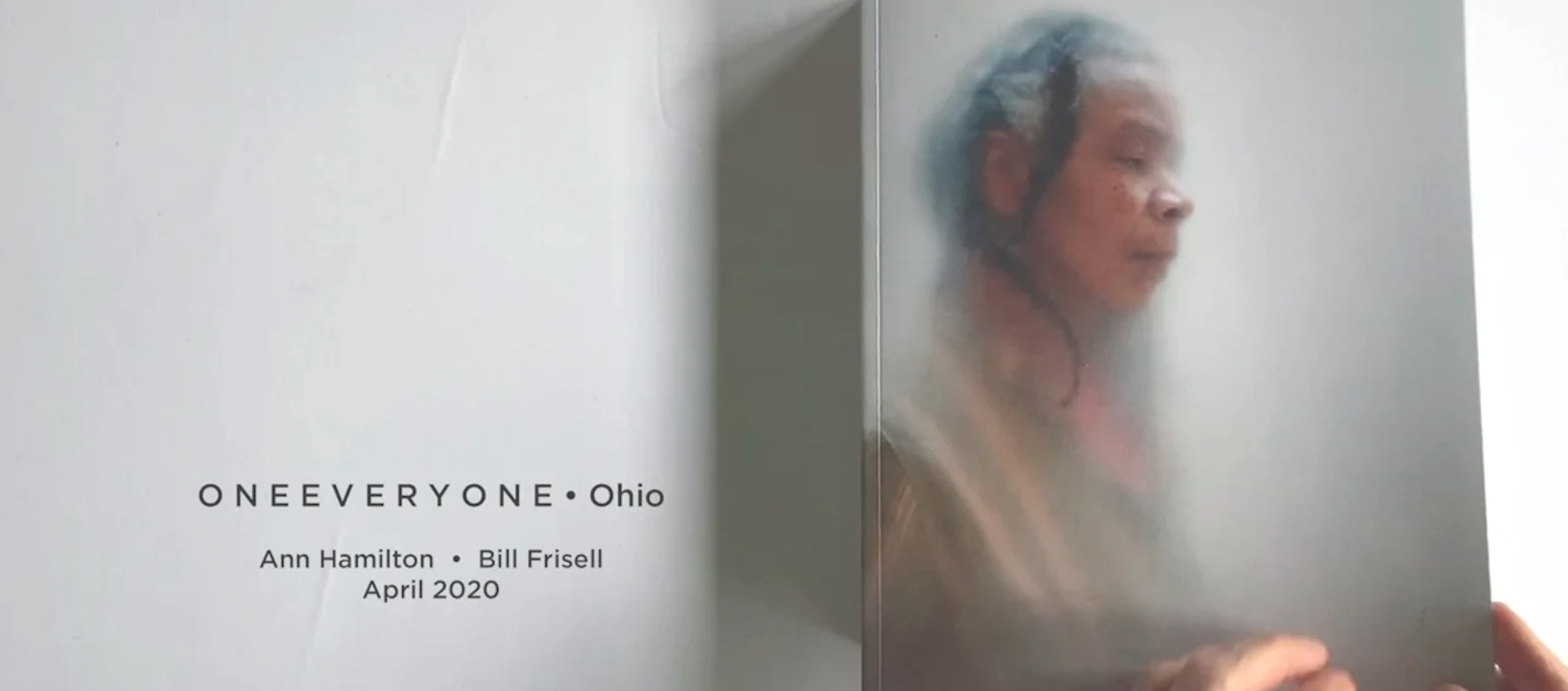 Opening image from the video of artist Ann Hamilton's ONEEVERYONE book. Dancer Bebe Miller is seen on the cover.