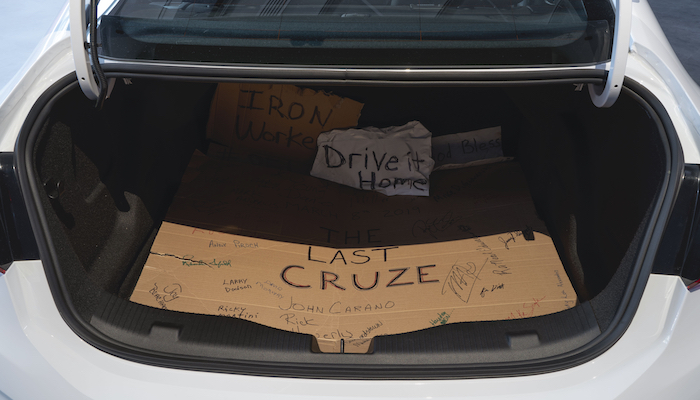 The interior of the truck of the last Chevy Cruze to be manufactured in Lordstown, Ohio, lined with handwritten signs from the workers who built it