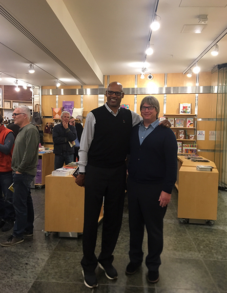 Clark Kellogg and David Filipi in the Wexner Center Store with other patrons behind them