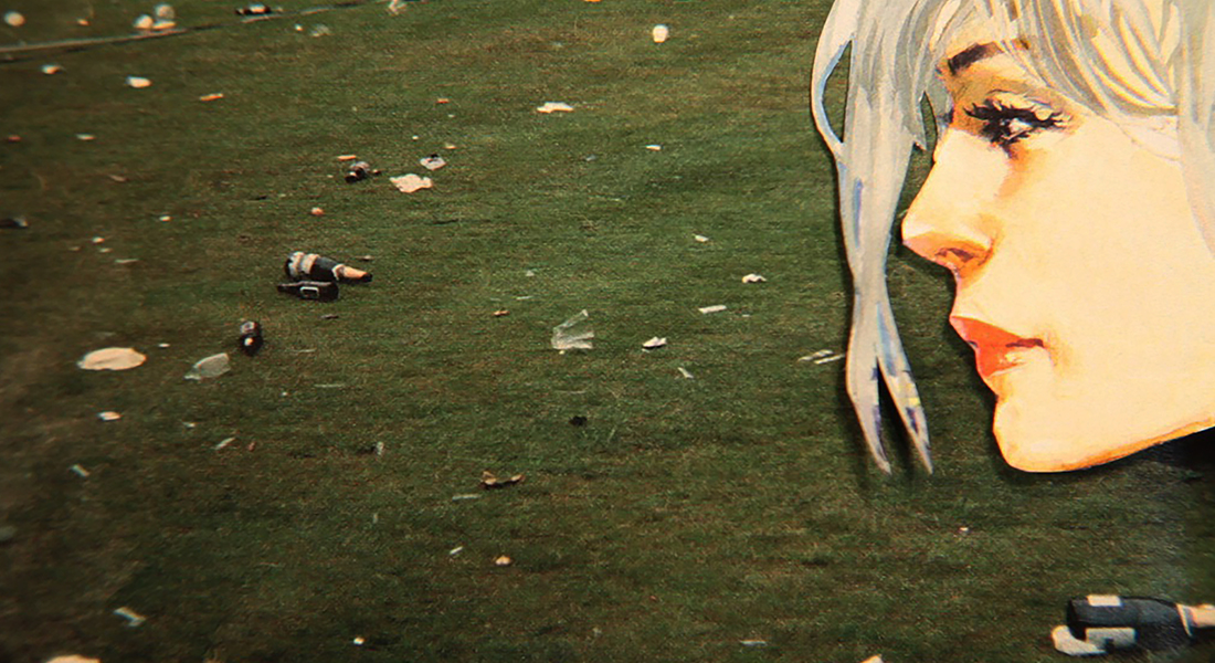 In this color collage, a still from the film, a paper cut out of a face looks out on a green field that's covered in trash.