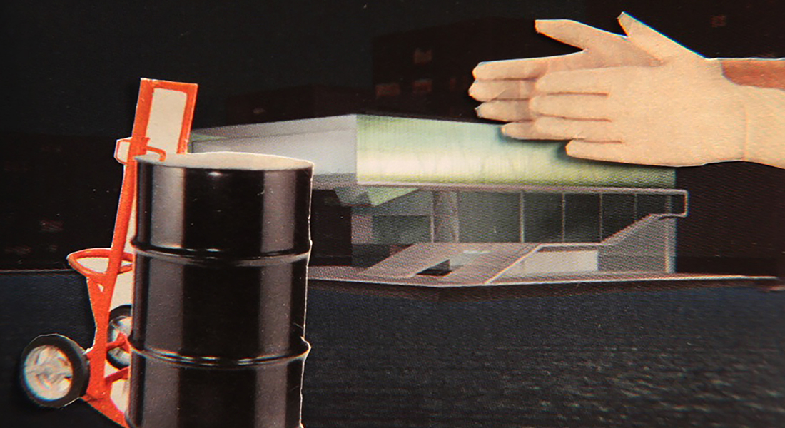 In this color collage, a still from the film, two hands hover over a modernist building while an oil barrel on a cart sits in the foreground.