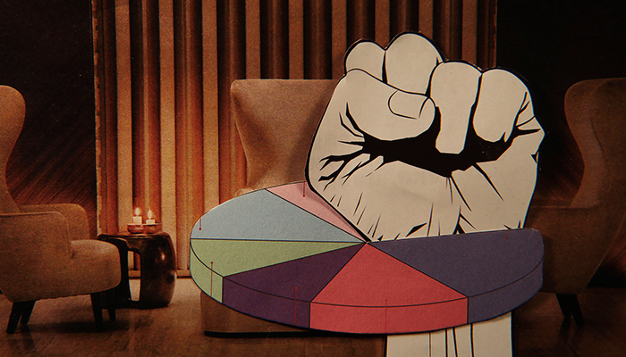 A paper fist punches through a pie chart with a vintage lounge setting as the background.