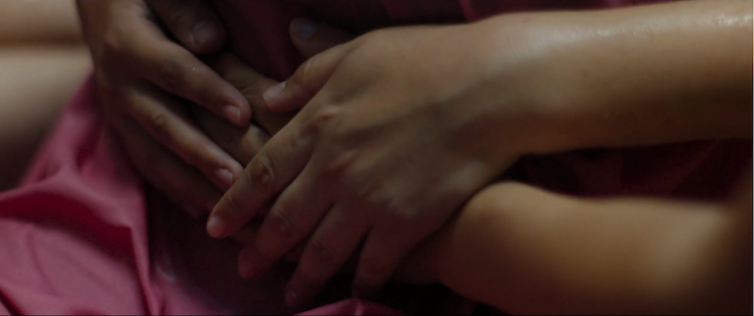 A scene of women's hands from the film Papicha