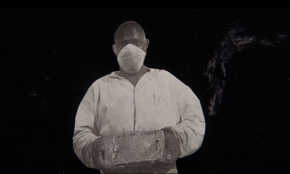 A man wearing an n95 mask and hazmat suit in a scene from Lewis Klahr's film Circumstantial Pleasures