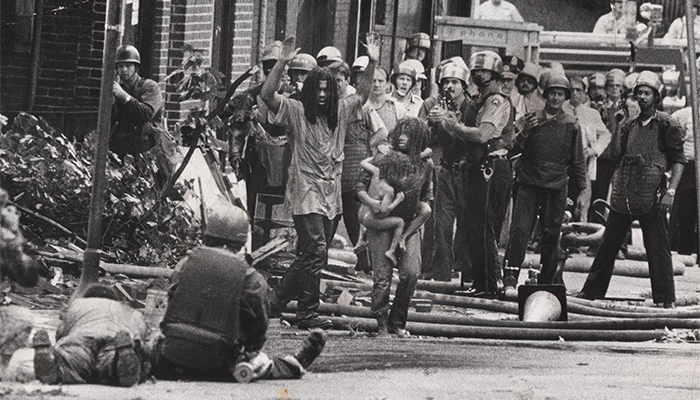Image of police harassing member's of Philadelphia's MOVE from the documentary Let the Fire Burn