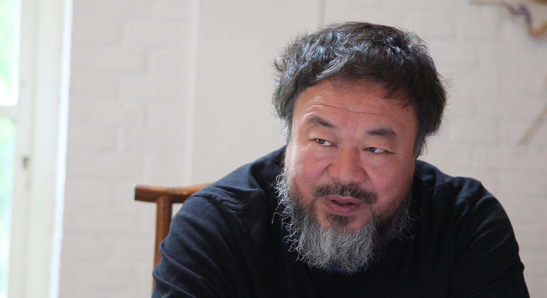 Photo of artist Ai Weiwei seated in a chair