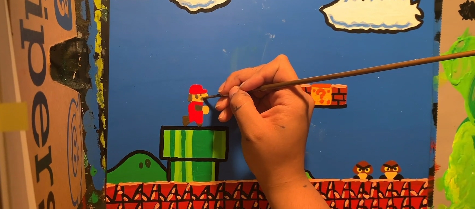 Artist Bethani Blake paints a miniature environment inspired by Original Mario Bros videogame