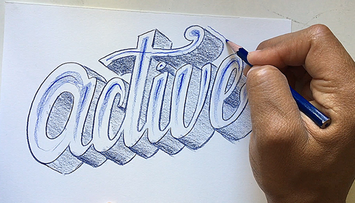 "The hand of artist and author Robert Liu-Trujillo drawing a decorative treatment of the word ""active"""