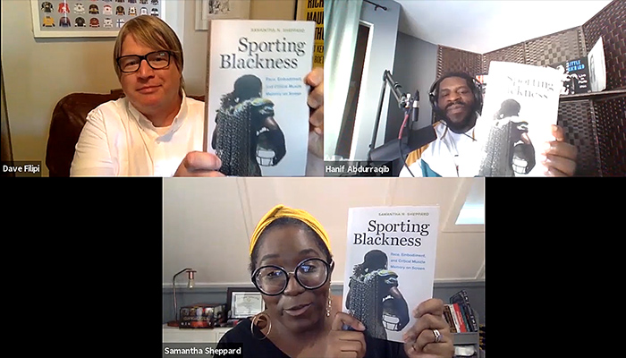 Three people in a Zoom call each hold up the book Sporting Blackness.