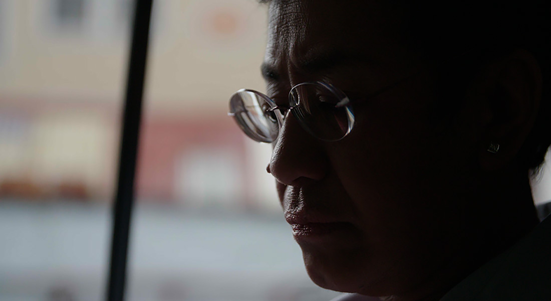 Journalist Maria Ressa, captured in a low-light close-up profile