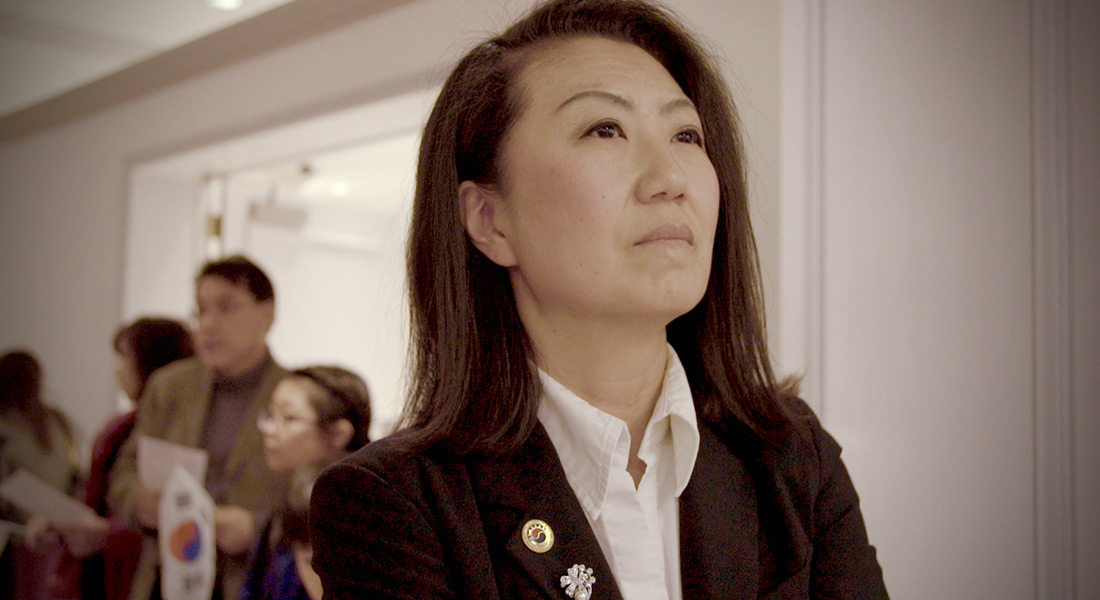 A close-up of Julie Cho looking off in the distance
