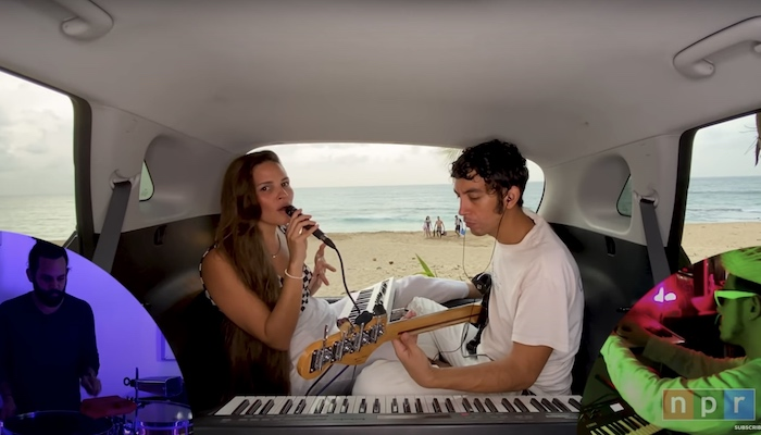 Puerto Rico band Buscabulla performs inside a car for an edition of NPR's Tiny Desk Home Concerts