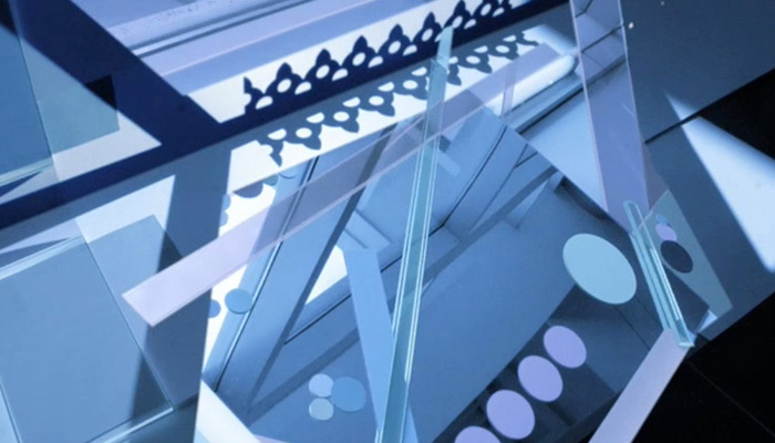 An abstract close-up of glass and metal architectural elements