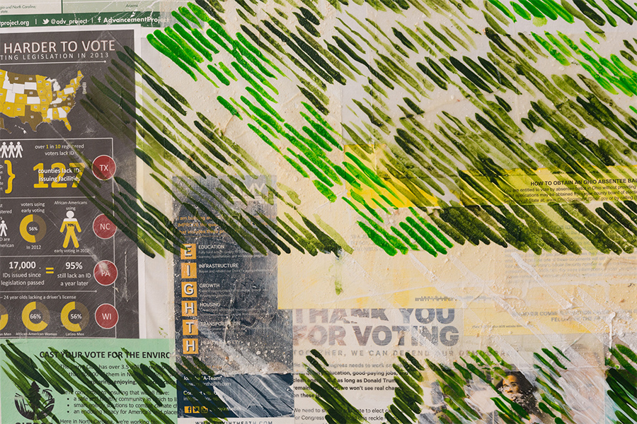 A detail of a collage painting depicts strokes of green and yellow paint over top print ephemera with messages about voting.