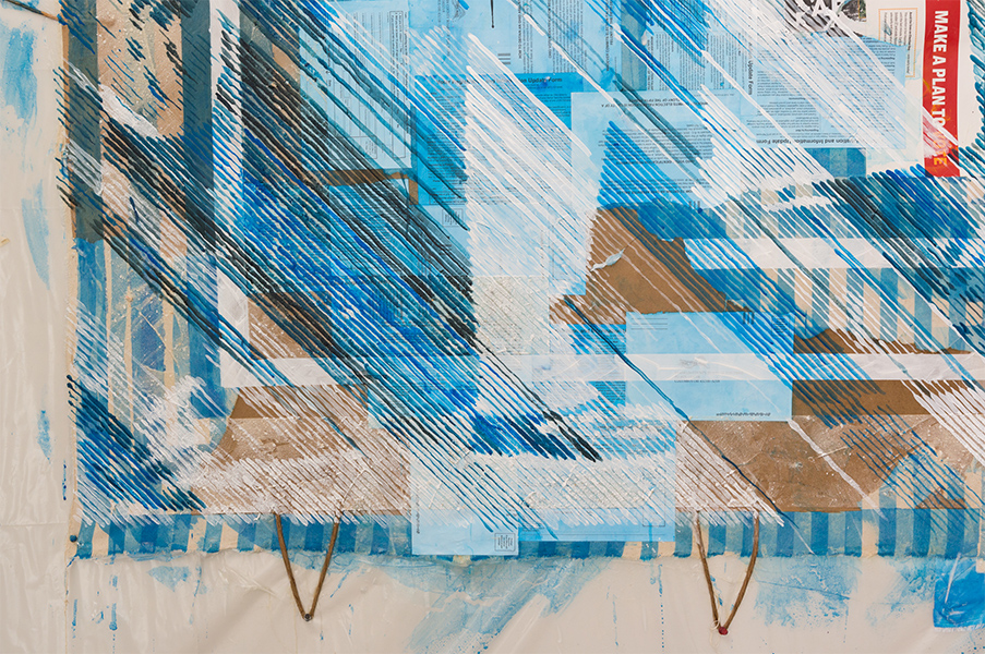 A detail of a collage painting with continue strokes of blue and white paint over top brown paper bags.