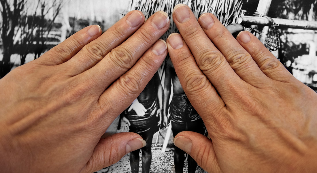 Two hands covering a black and white image