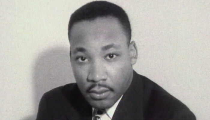 Black & white photo of Martin Luther King, Jr. looking at the camera