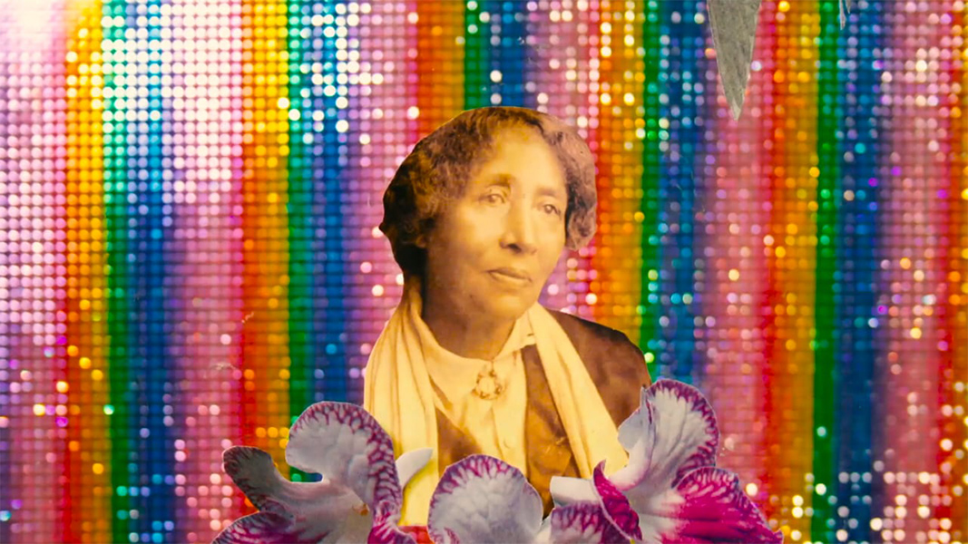 A collage of a photo go an old woman in sepia tones and cut-out images of purple and white flowers against a spangly rainbow background