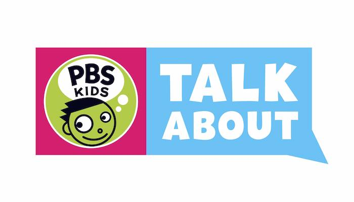 "The PBS Kids logo in green, black, and white, on a rectangular word balloon field with pink behind the logo and ""talk about"" in white on light blue next to it"