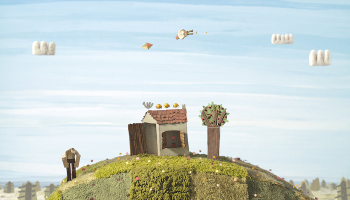 Scene of a boy flying over a small house like a kite as a man on the ground watches, from the animated film The Kite