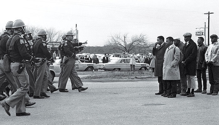 African American protesters face off against police during the Civil Rights Movement in an archive image from the documentary I Am Not Your Negro